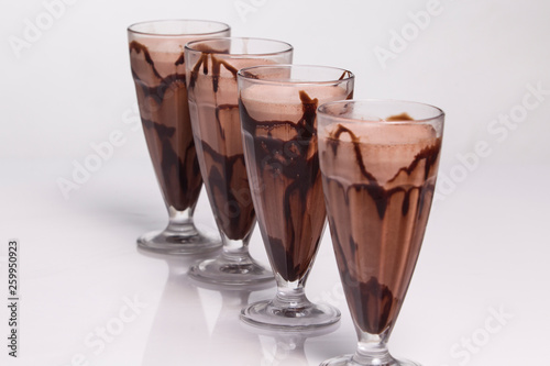 glass of chocolate flover milk shake isolated on white background