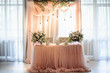 canvas print picture - Beautiful festive decor. Wedding presidium. Table is decorated with bouquets of flowers and candles