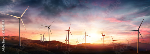 Obraz Wind Turbines In Rural Landscape At Sunset - fototapety do salonu