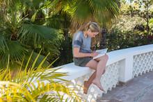 12 Year Old Girl Reading On Terrace, Todos Santos, Mexico