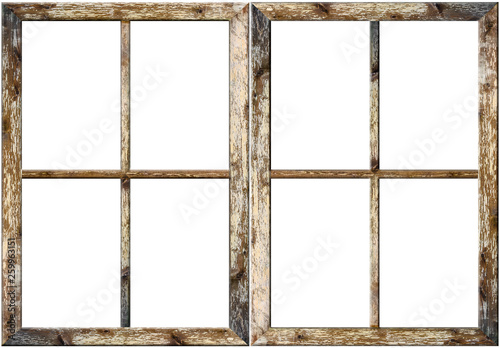 Very aged wooden window frame with cracked paint on it, mounted on a grunge wall