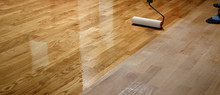 Lacquering Wood Floors. Worker...