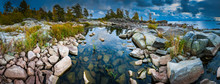 Russia. Karelia. The Rocky Shore Of The Island. Rocky River. Large Stones Flooded With Water. Karelian Landscape. Wildlife Panorama. Stony Shore On Lake Ladoga. Ladoga Lake.