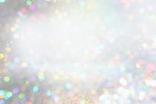 Glitter Silver Lights Background. De-focused