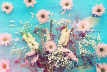 Spring Bouquet Of Pink And White Flowers Over Blue Vintage Wooden Background. Top View, Flat Lay
