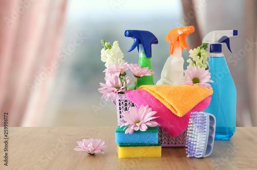 Fotografie, Obraz  Spring cleaning concept with supplies on wooden table