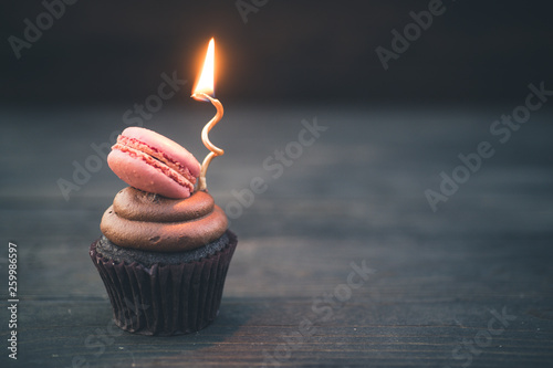 Photo  Chocolate Cupcake, French Macaron & Gold Candle