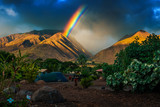 Fototapeta Tęcza - Rainbow over the mountains and tent set in the camping. Maui, Hawaii