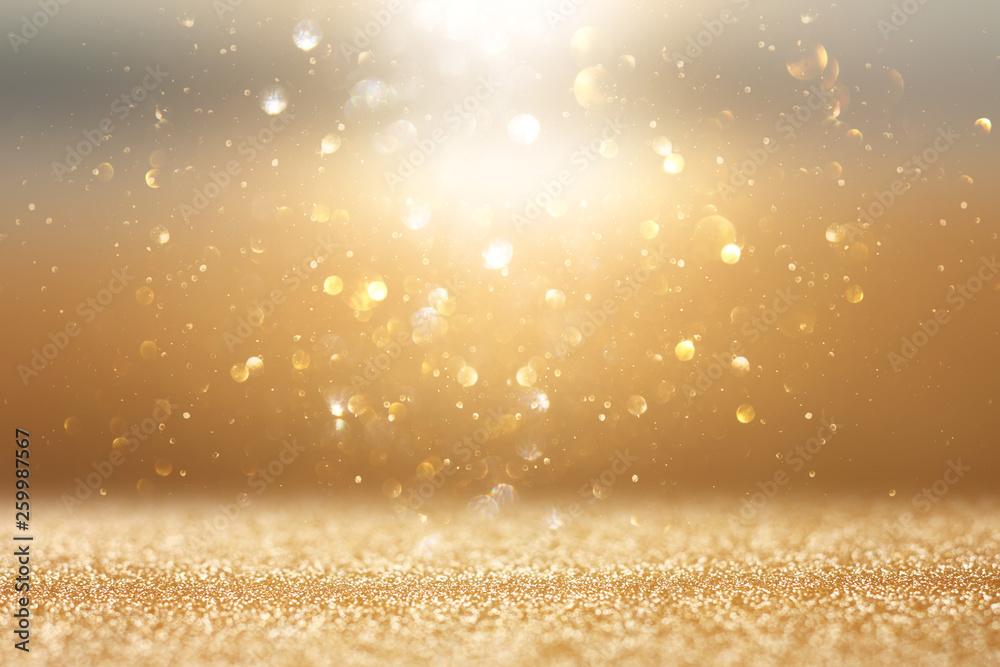 Fototapeta photo of gold and silver glitter lights background