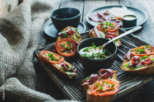 Fotografie, Obraz  rustic breakfast, baked with basil, tomato, salami and cheese slices of bread, f