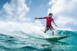 canvas print picture Surfer rides the wave at sunny day