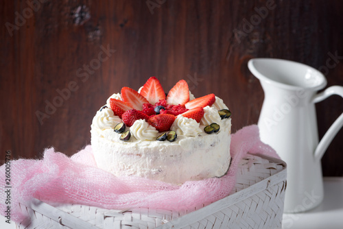 Delicious homemade cake with fruit and cream decorated with fresh fruits (baked Wallpaper Mural