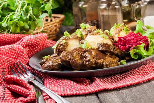 Fotografie, Obraz  Pork tenderloin in mushroom sauce with boiled potatoes and salad