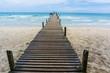 Wooden pier pathway to sea beach