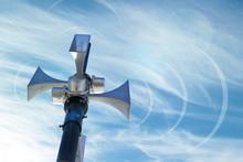 Outdoor Loudspeaker Against The Background Of Blue Sky, Sound Waves.