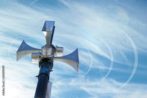 Carta da parati Outdoor loudspeaker against the background of blue sky, sound waves