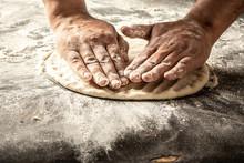 Chef Hands Cooking Dough On Dark Wooden Background. Man Preparing Bread Dough. Food Concept