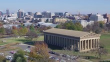 Slow Aerial Pan Of Centennial Park, With Nashville City In The Distance On Sunny Day 4k
