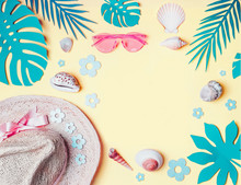 Summer Background. Beach Accessories With  Shells And Tropical Leaves On Light Yellow Background, Top View. Straw Hat And Sunglasses. Summer Holiday Vacation. Female Fashion Outfit . Flat Lay