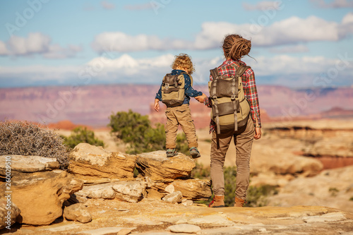 Obraz na plátně  Hiker with boy in Canyonlands National park, needles in the sky, in Utah, USA