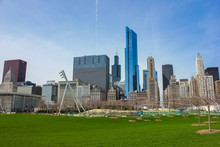 Chicago, Illinois, USA - May 27, 2015- Millennium Park. View From Millennium Park To The Skyscrapers Of Chicago, USA. Warm, Sunny Day Of Spring