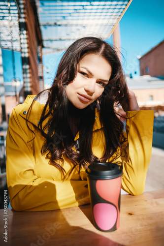 Woman Drink Her Hot Coffee On The Street  Portrait Of