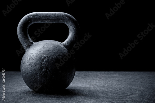 Fotografiet  kettlebell on a black background
