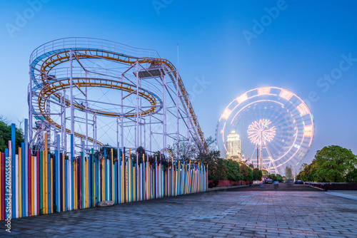 Wall Murals Amusement Park Roller coasters and ferris wheels in amusement parks。