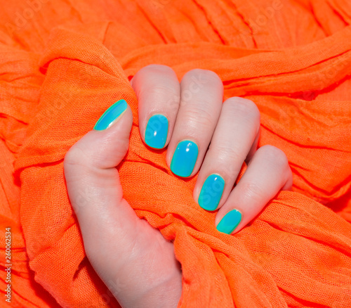 Beautiful blue manicure in light Canvas Print