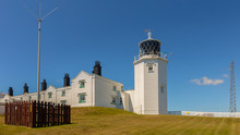 Lizard Lighthouse In The South Of Cornwall With Blue Sky In The Background