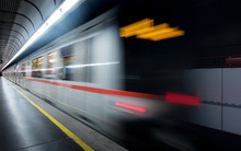 Blur Of Moving Light Trail Of Train In Subway And Passenger At Platform For Transportation In Business City Of Europe