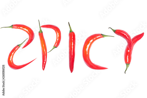 "Fotografie, Obraz  Red chilli peppers in ""SPICY"" text on white background"