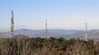 Radio transmission tower under blue sky