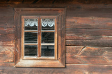 The Old Window Of Old Wooden House. Background Of Wooden Walls
