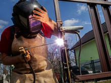 Man Is Welded To A Steel Gate Metal Latch.