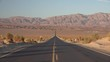 Classic road view across Death Valley Death Valley National Park CA USA.