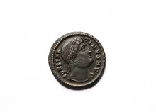 Ancient Roman Coin With Portrait Of Emperor Isolated On White