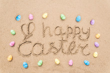 Happy Easter Lettering Background With Eggs On The Sandy Beach