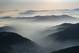 Mountains and mountains, crest and low clouds - 260121940