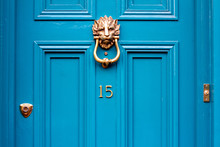 House Door Number Fifteen With The 15 In Bronze On A Turquoise Door With Lion Head Door Knocker