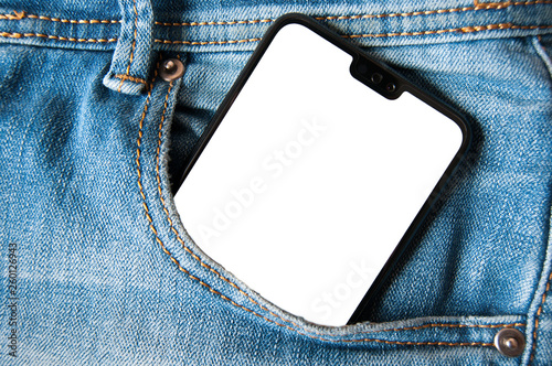 Fotografía Smartphone with isolated white screen in a denim jeans pocket