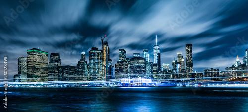 Manhattan panoramic skyline at night. Office buildings and skyscrapers. Manhattan, New York City, USA..