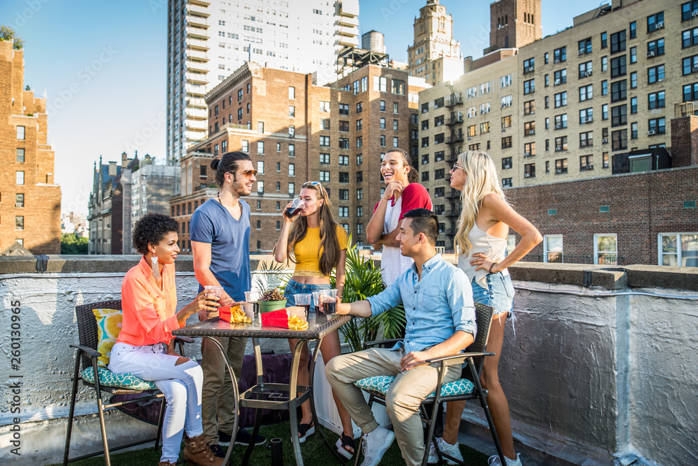 Fototapety, obrazy: Group of friends having party on a rooftop