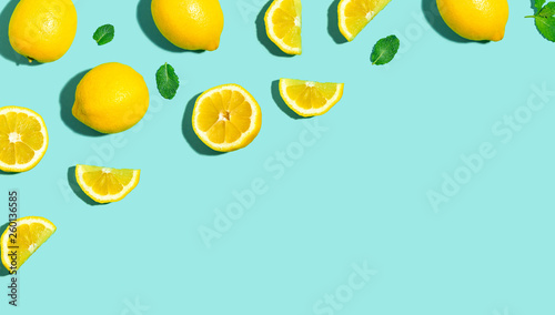 Cuadros en Lienzo  Fresh lemon pattern on a bright color background flat lay