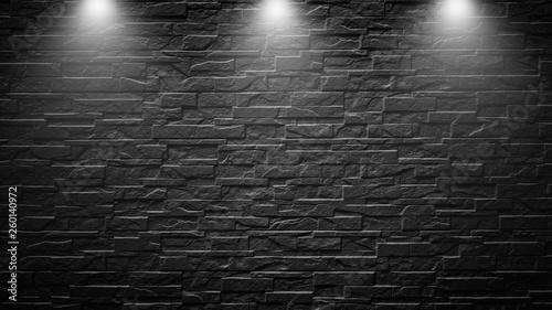 Foto op Plexiglas Highly contrasted spotlights on an outdoor black brick wall