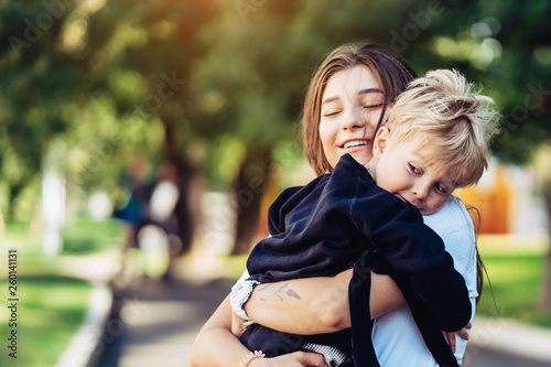 Fototapeta Beautiful young mother holds on hand her little son obraz