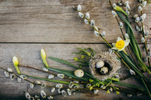 Easter Eggs And Easter Decorations Lying On Wooden Rustic Table