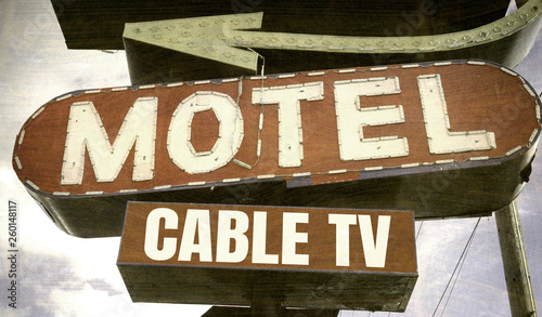 aged and worn vintage neon motel sign
