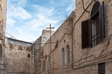 A Cross In A Courtyard In The ...