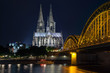 Cologne Cathedral and railway bridge over the river Rhine (Germany)
